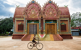 Boy on bike - Wat Hanchey, Cambodia
