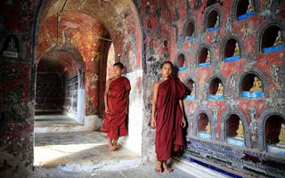 monks standing near a wall