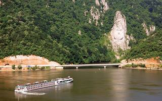 Scenic cruise on River danube at Iron Gates, Rock sculpture of Decebalus