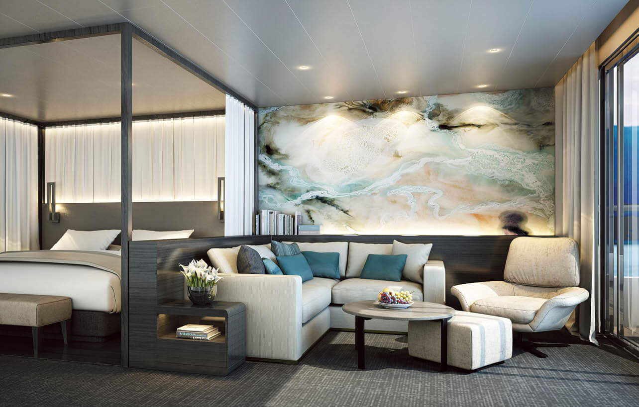 a luxury designed cruise suite with an exclusive living area located in the corner