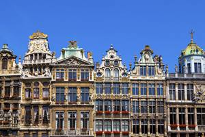 a large building with Grand Place in the background